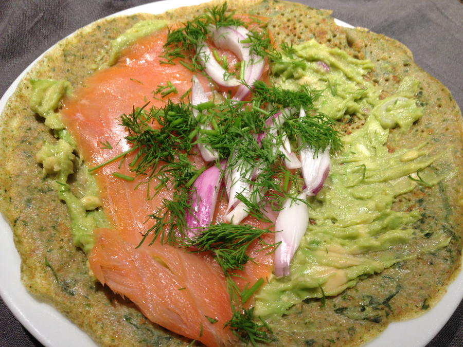 Salmon, avocado, onion and herbs on a sourdough crepe